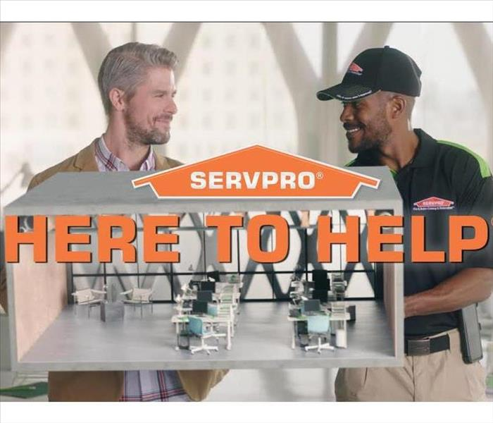 SERVPRO technician with customer