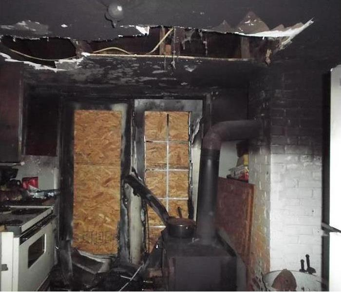 Board up doors in a kitchen after a fire loss